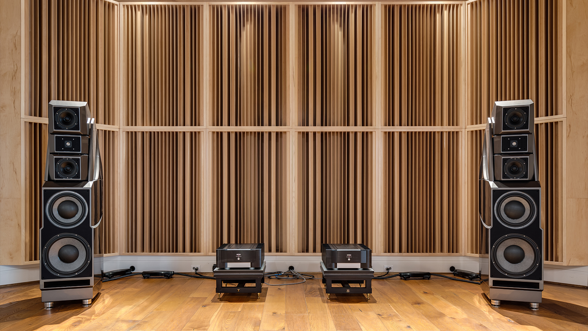 wall of acoustic sound diffusers with wilson audio speakers in front
